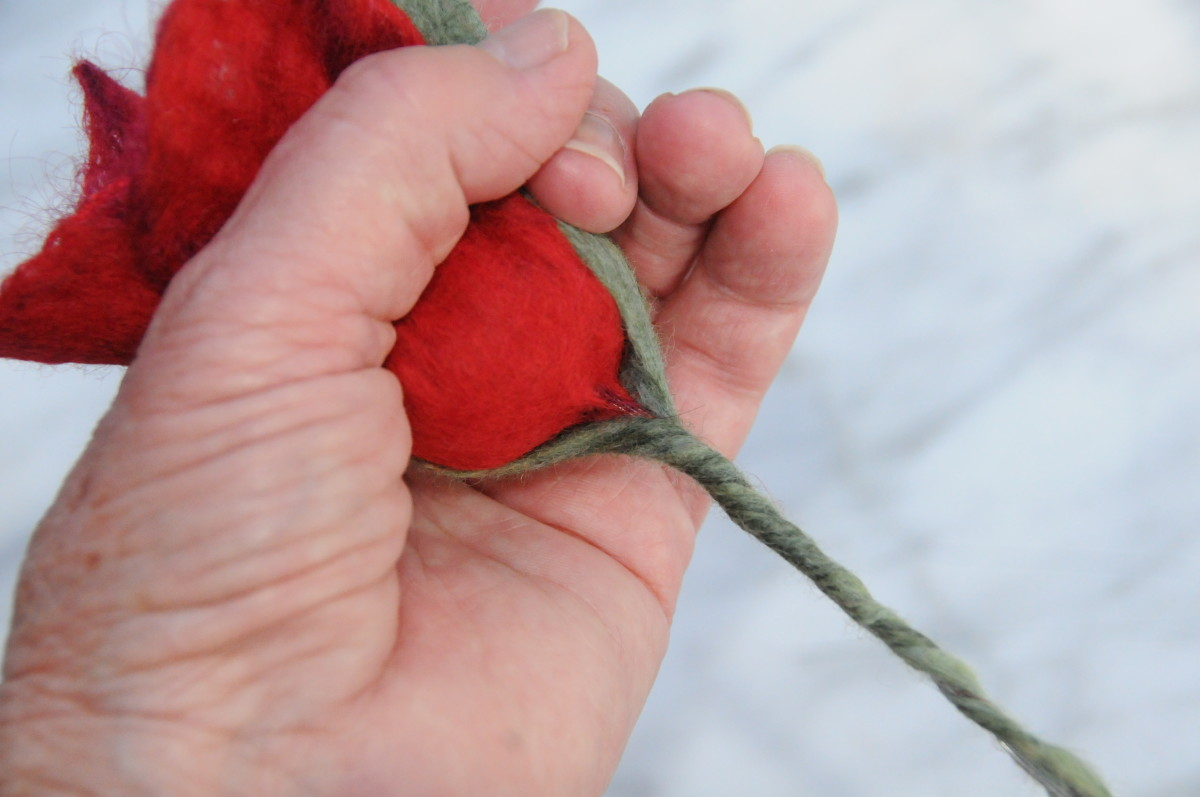 Cup the petals in your palm and then gently shape them into a pleasing shape.
