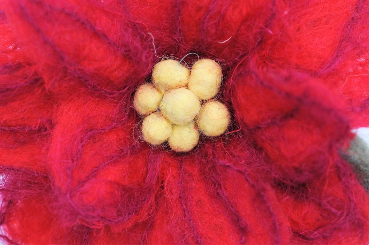 Close up detail on the felt poinsettia
