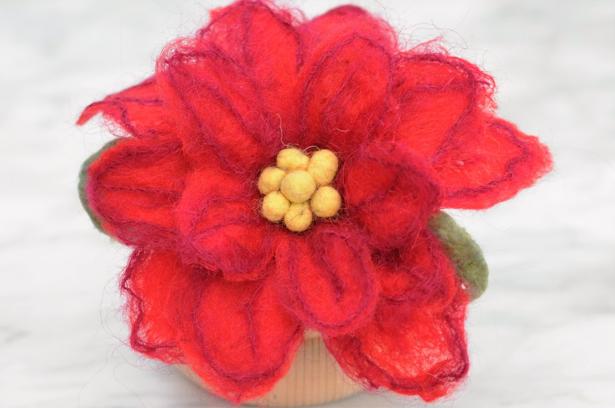 Close up of a wet felted poinsettia.