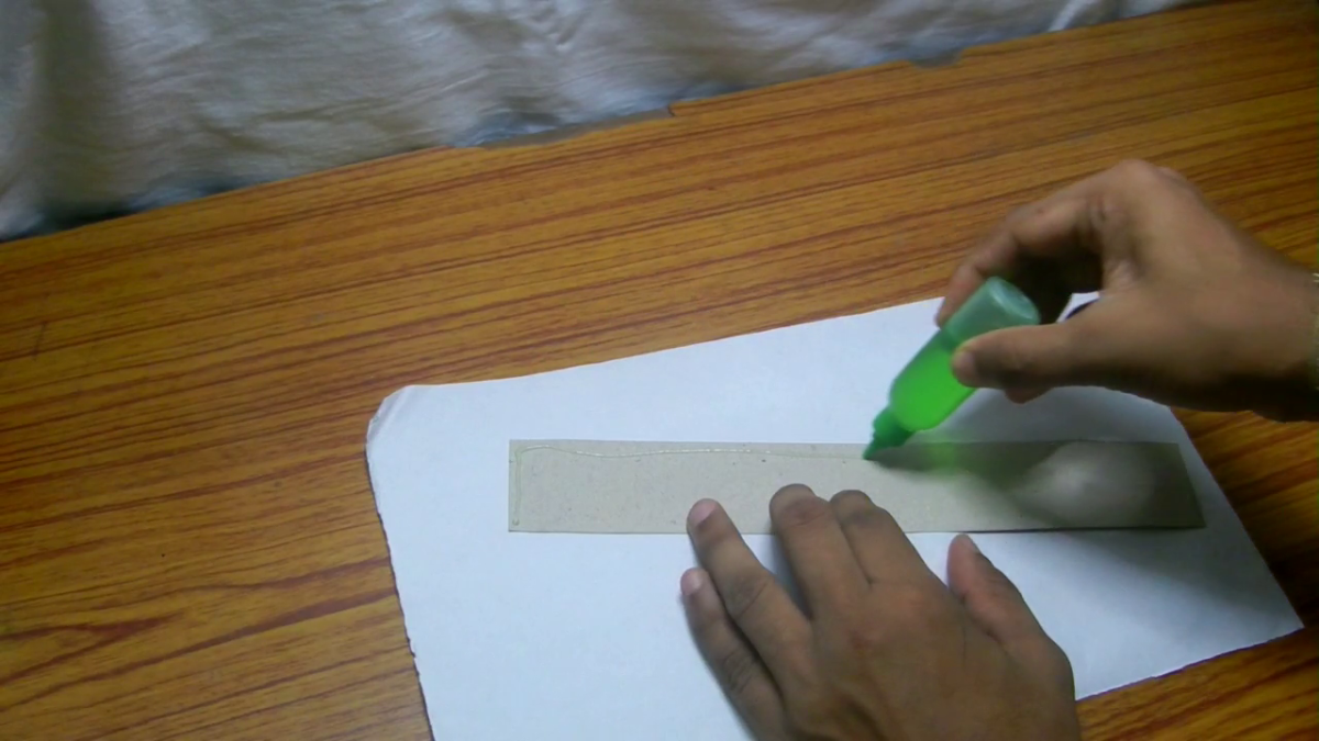 Paste a thin white paper over the thick paper to make it suitable for designing the house.