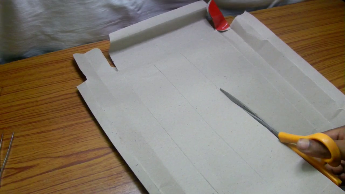 Cut the paper using a scissor.