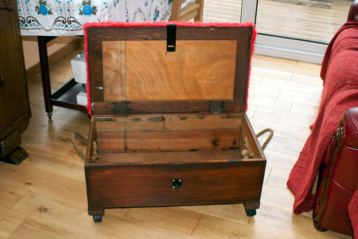 Conversion from tool chest to sewing box; complete with caster wheels and padded seat