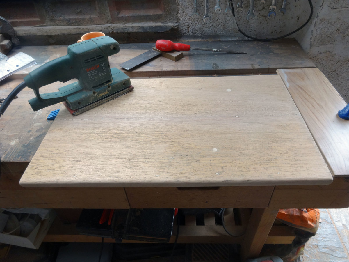 Sanding smooth the newley made teak table top
