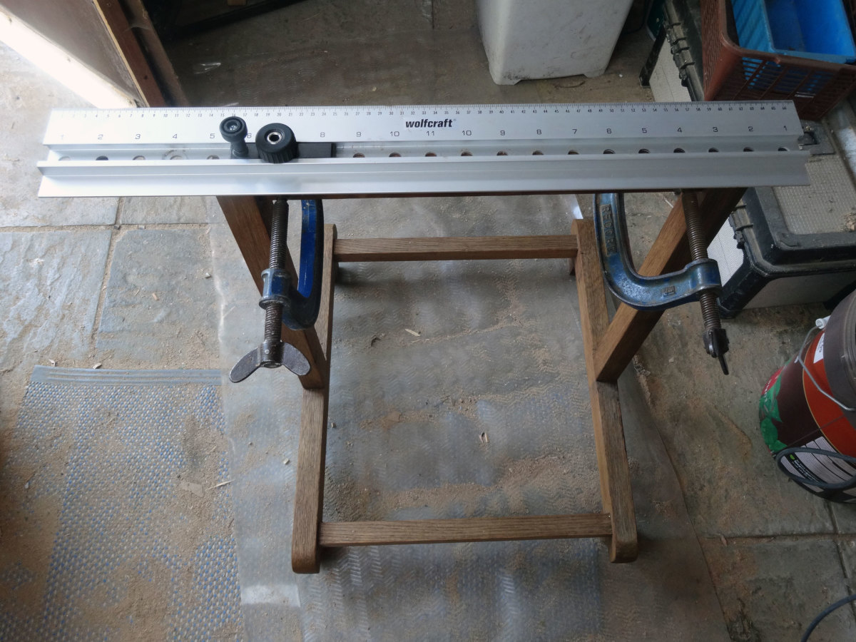 Using a Wolfcraft dowel joint jig on the cross bar of the legs for fitting the table top