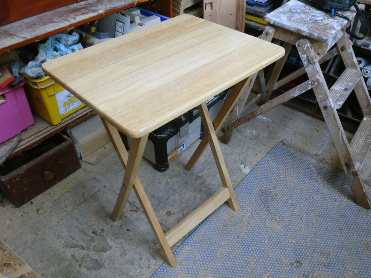 The original folding pine table replaced by the new sofa tables.