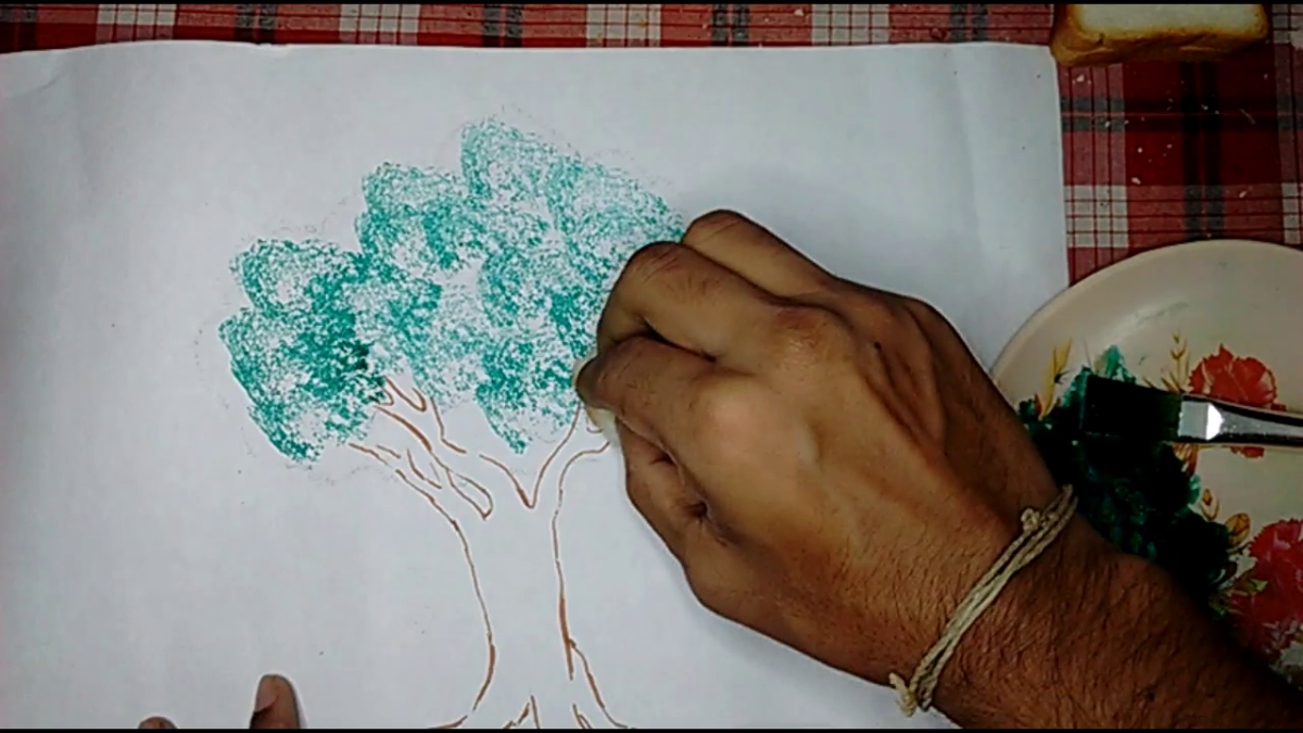 Step 6- use the bread to make designs of the tree leaves by softly tapping it on the drawing paper. Remember to repeatedly change the bread pieces after their usage to ensure good patterns for the leaves.