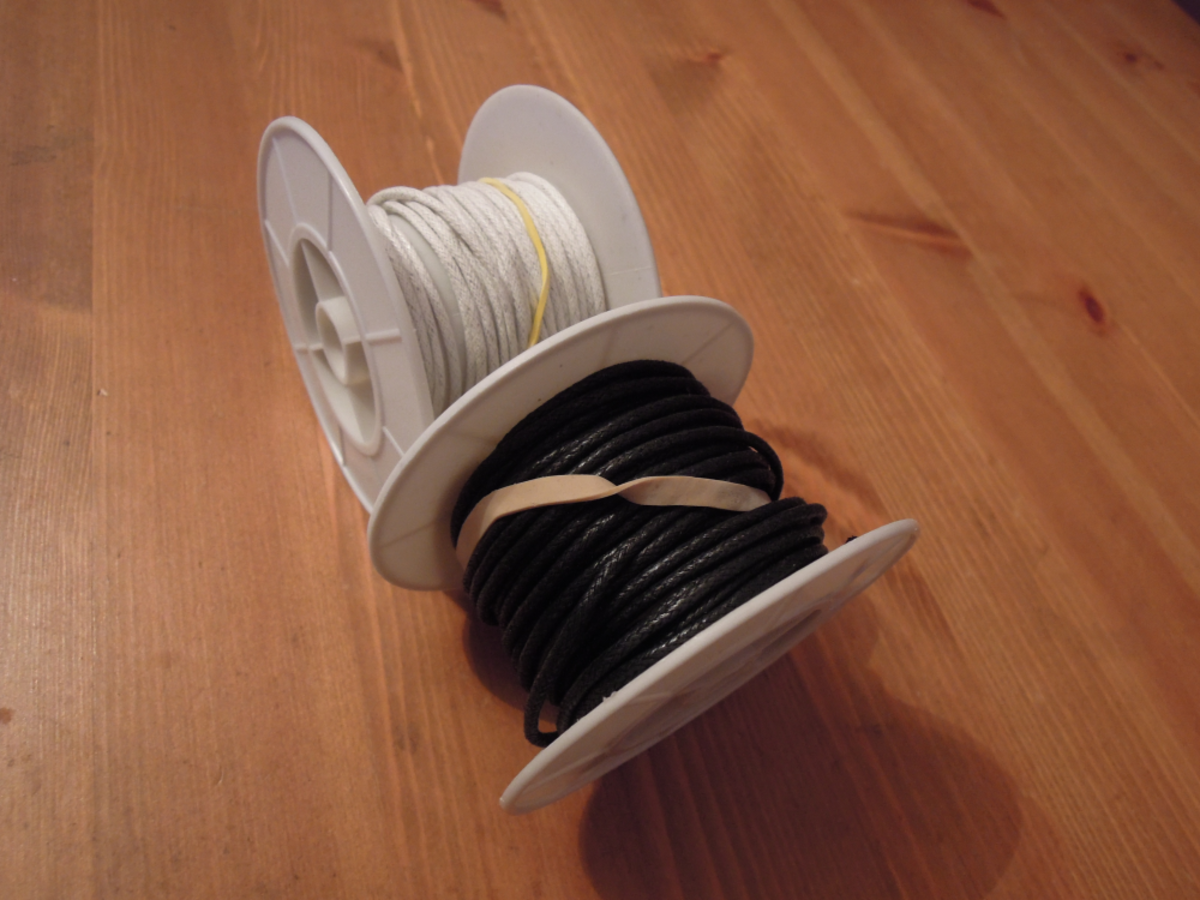 Spools of waxed cotton cord.