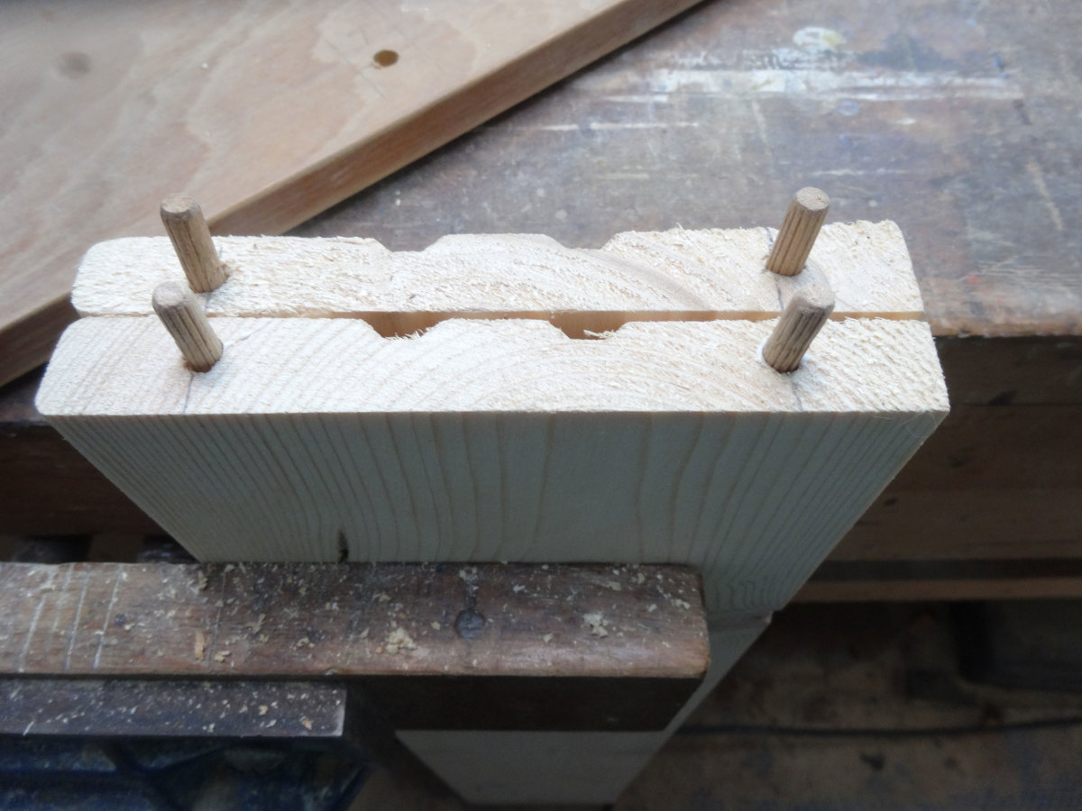 Dowel glued into the ends of the shelves.
