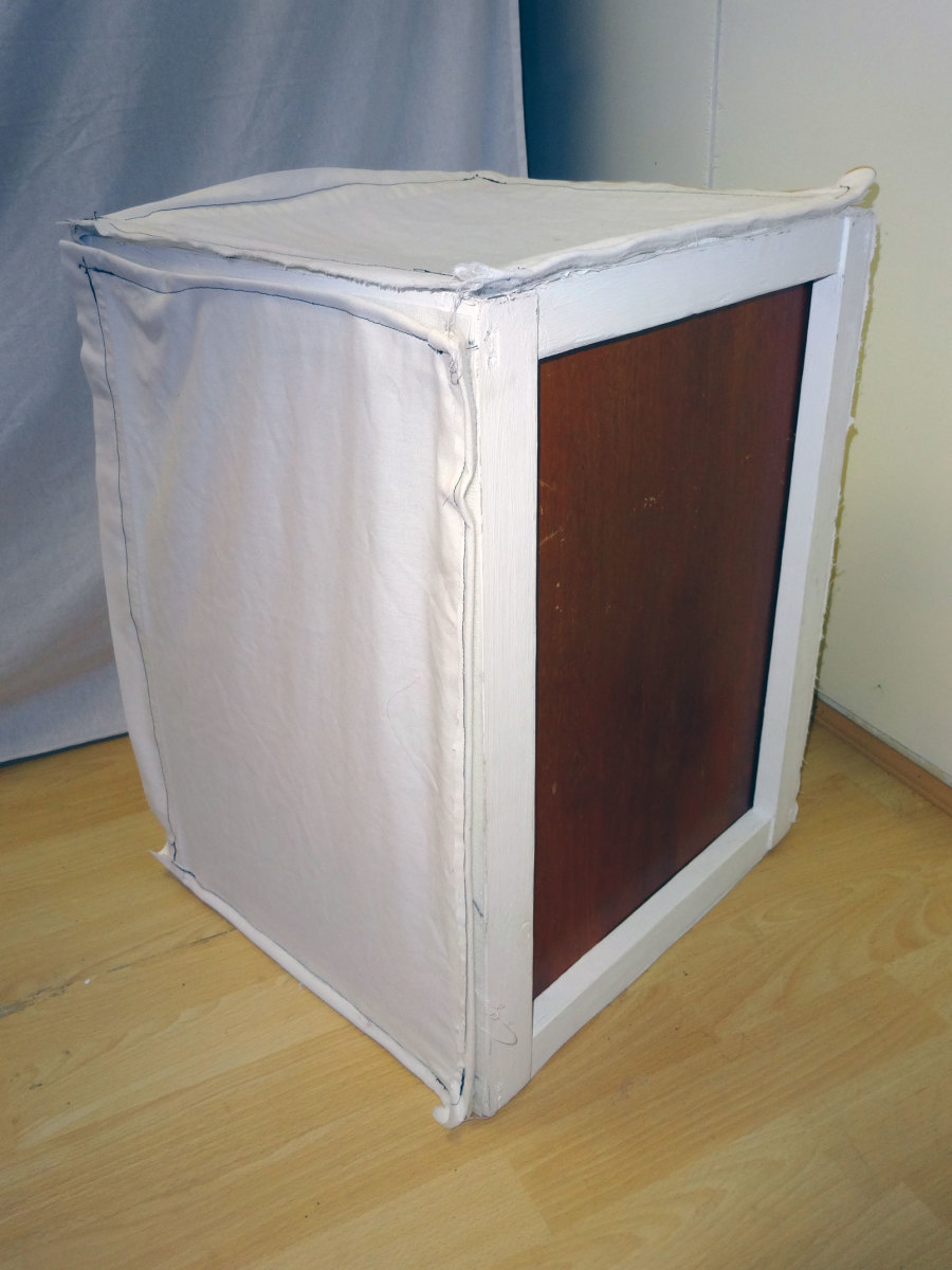 Plywood base, covered with white sheet on the inside.