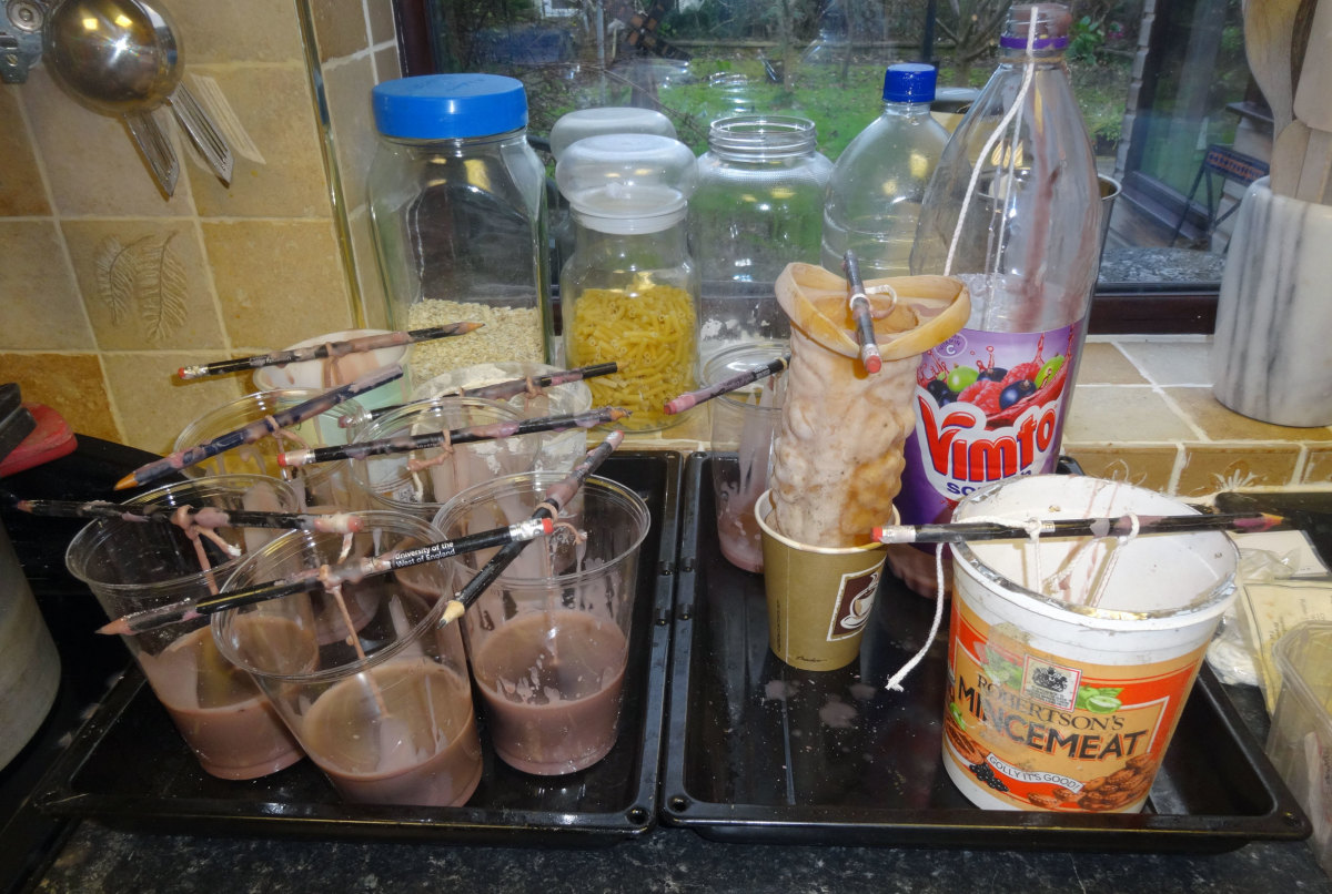 Vimto bottle and other containers being used as candle moulds.