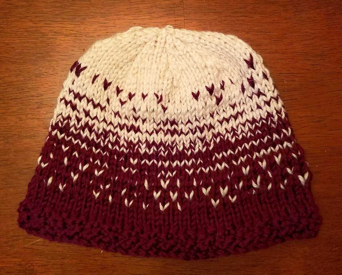 Deep Purple to White Ombre knit hat, with the double stranded and Fair Isle method.