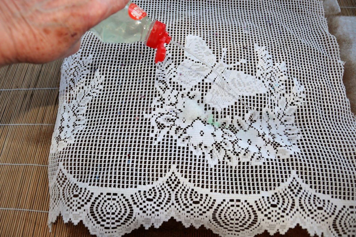 Cover the wool batt with a piece of curtain netting.