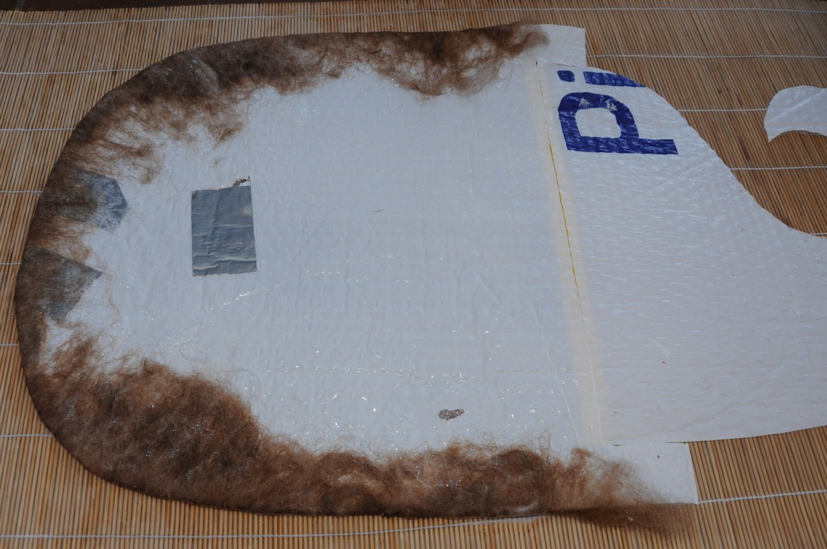 Fold the fibres over the edge using hot soapy water.