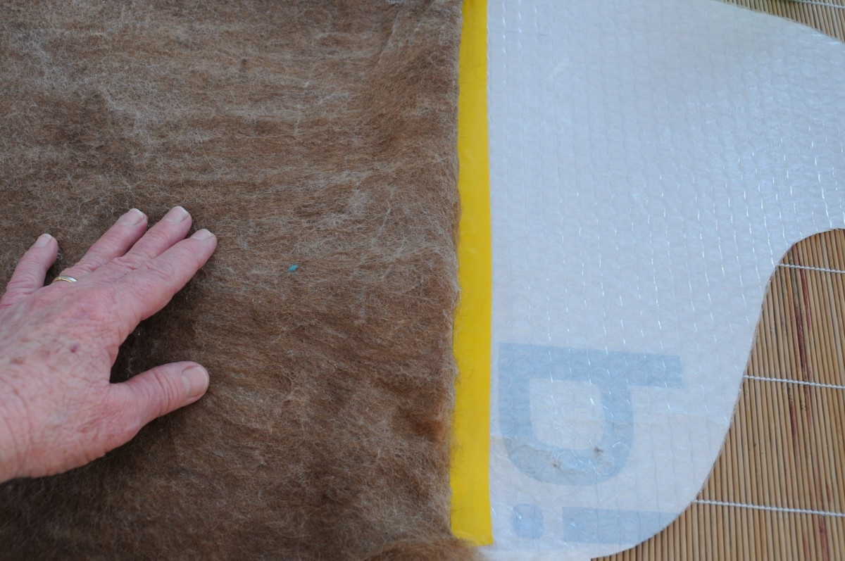 Turn the top edge over, form a straight line across the taped edge of the template.