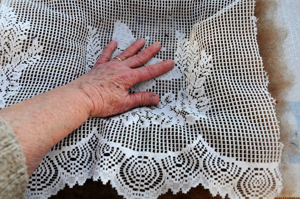 Press down on the wet fibres. flatten and rub gently.