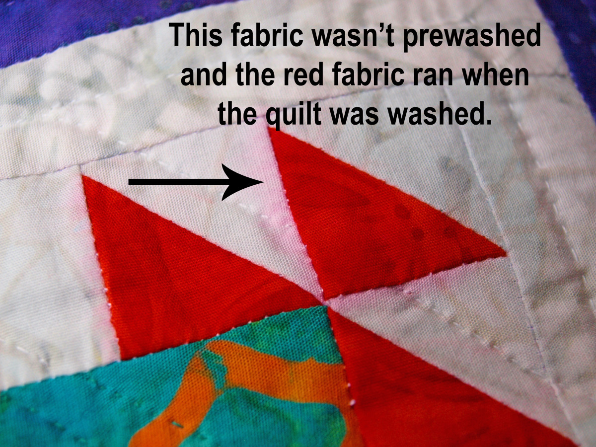 Prewashing fabrics helps avoid problems like the one in the photo.  Always follow the fabric washing instructions.