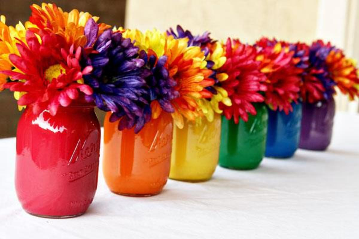 Mason jars can either be painted, or you can find multicolored mason jars that are ready to order if you're pressed for time!