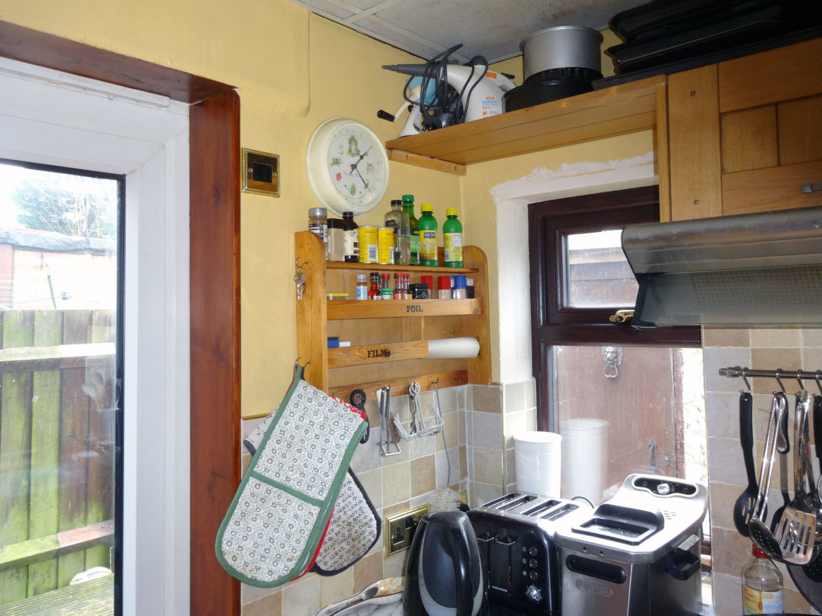 Original spice rack; clock and light switch to be moved to maximise on use of space.