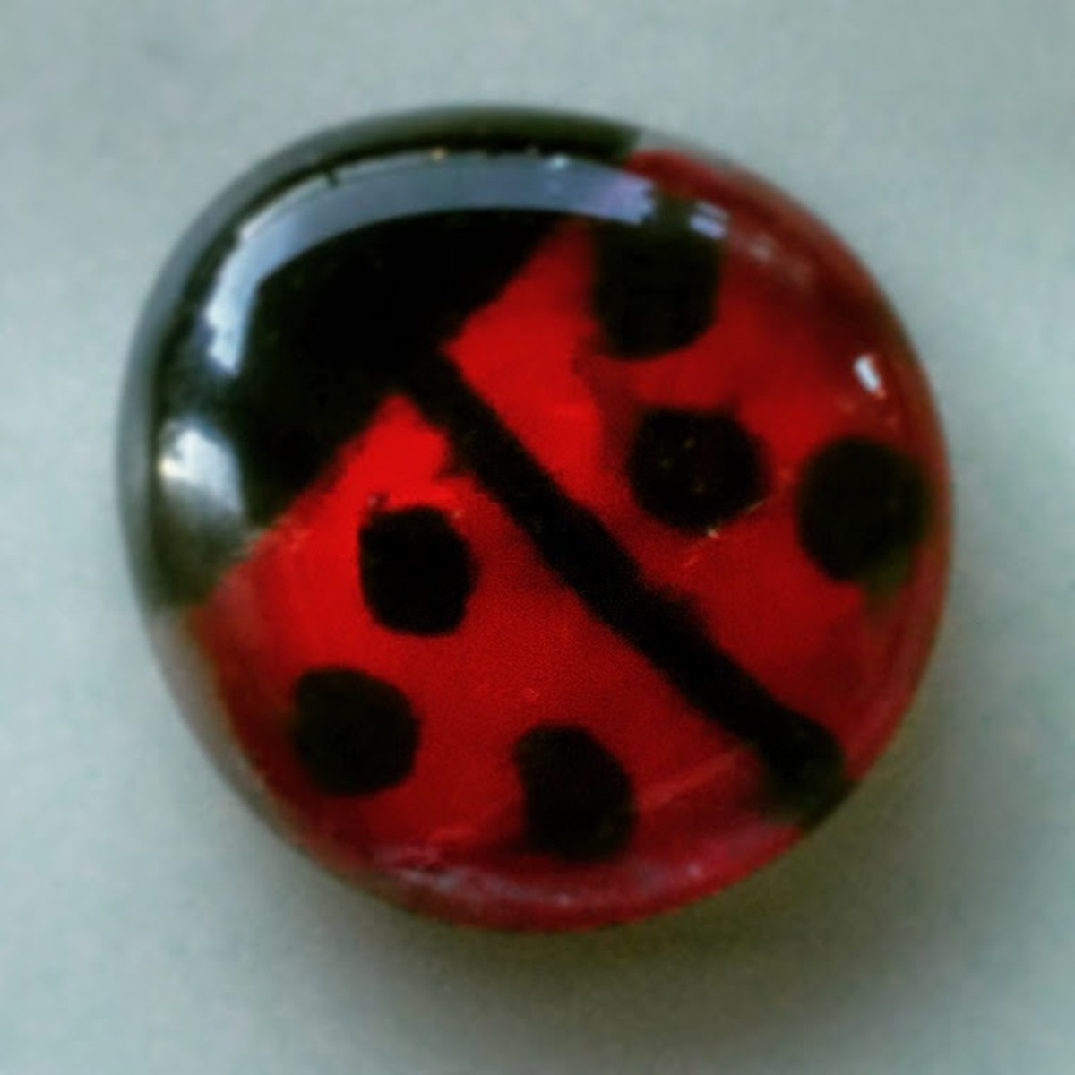 The black ink smeared a bit when I applied the red nail polish but I like the watery effect it gives the ladybug.