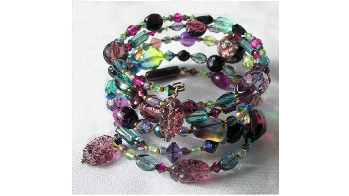 One-of-a-kind coil bracelet designed by Margaret Schindel features a mix of contemporary and vintage glass beads on memory wire
