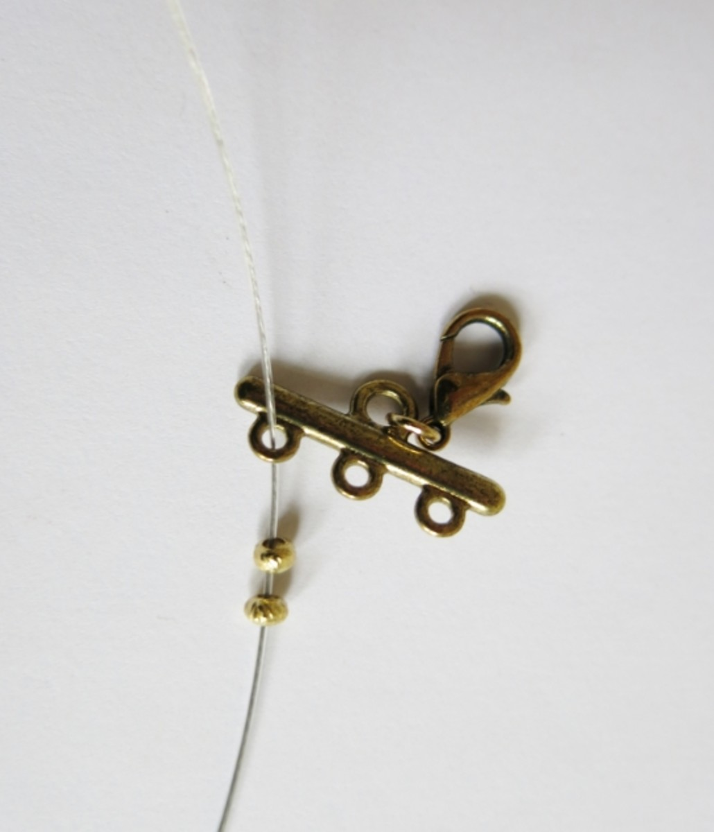 Attaching the clasp to your multi-stranded necklace.