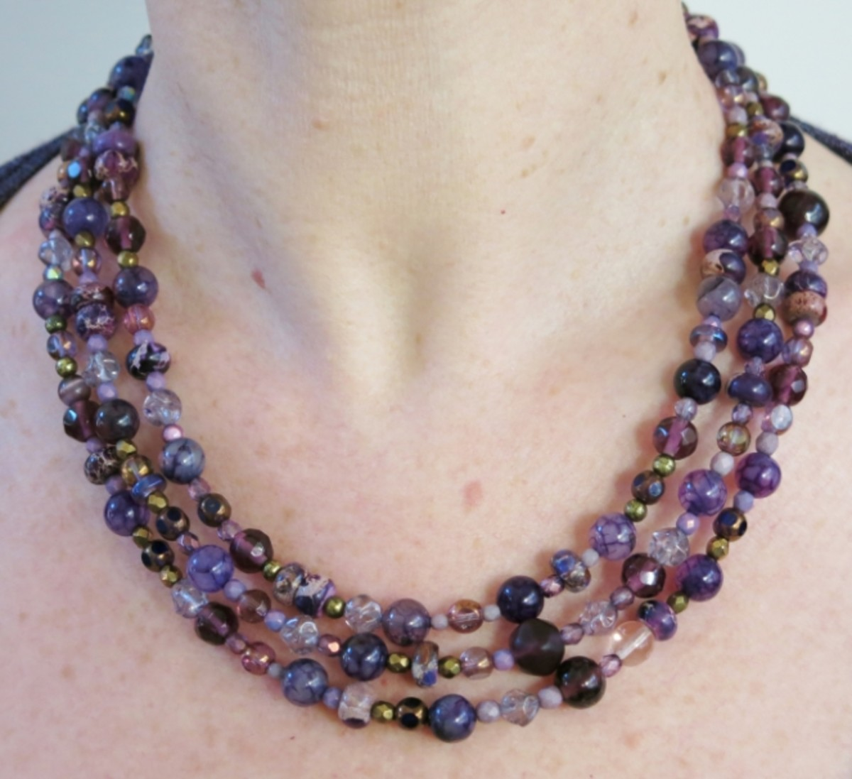 Directions for making a multi-strand beaded necklace.