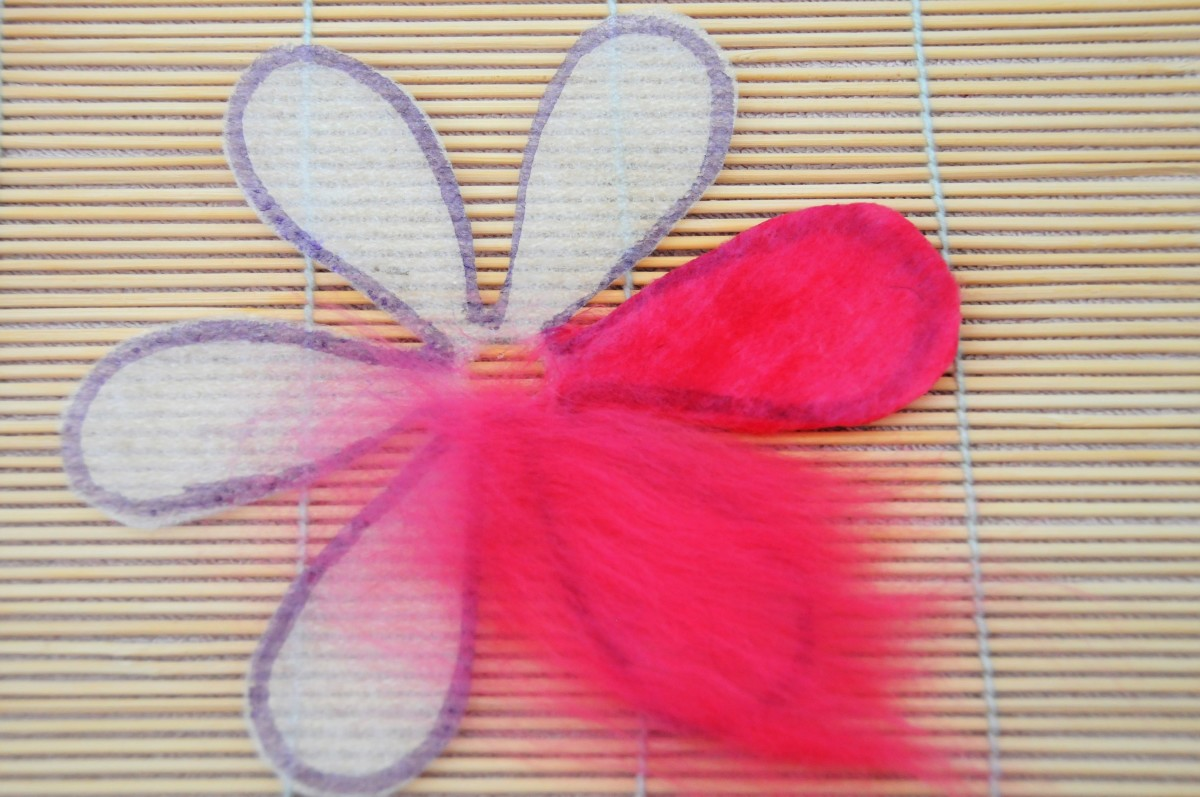 Covering the template petals with wool