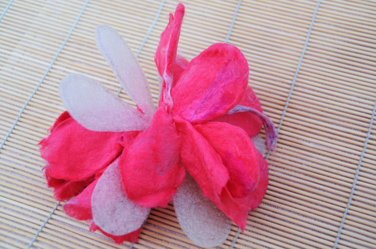 Cut through all of the petal layers, expose the templates and remove leaving the petals behind.