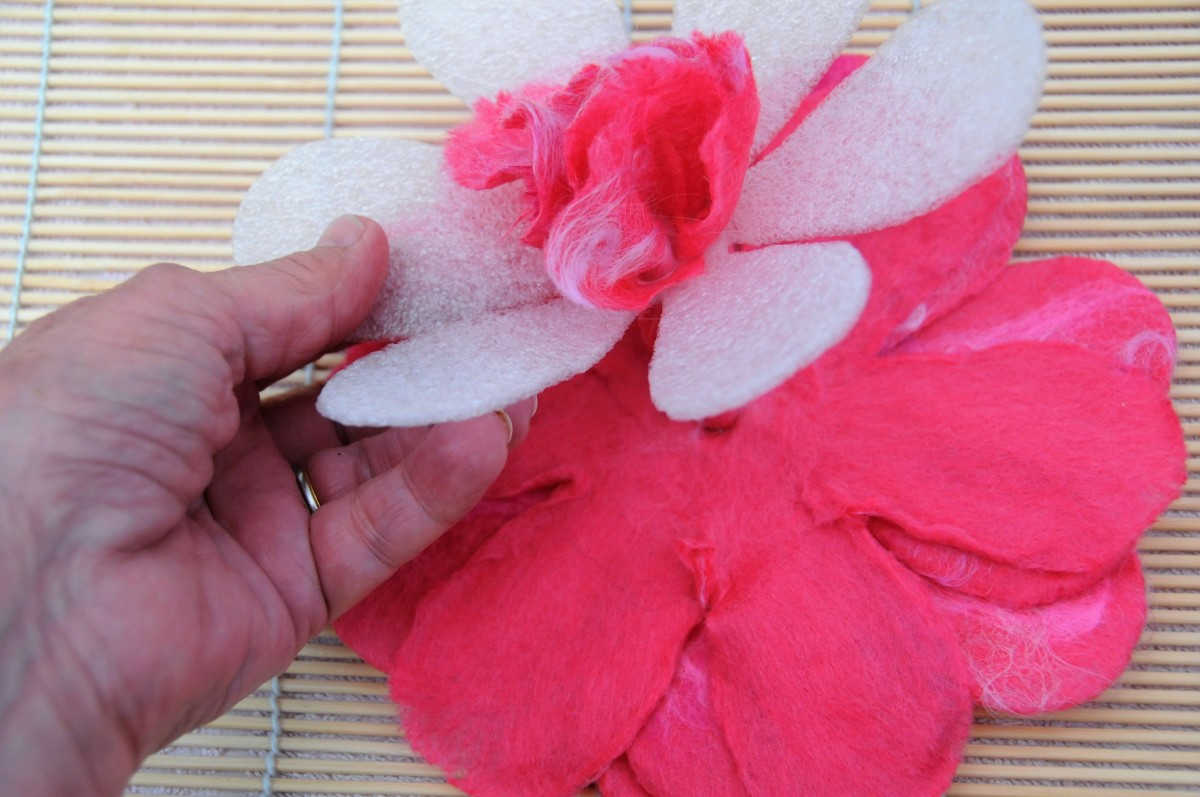The petals being drawn through the hole in the template