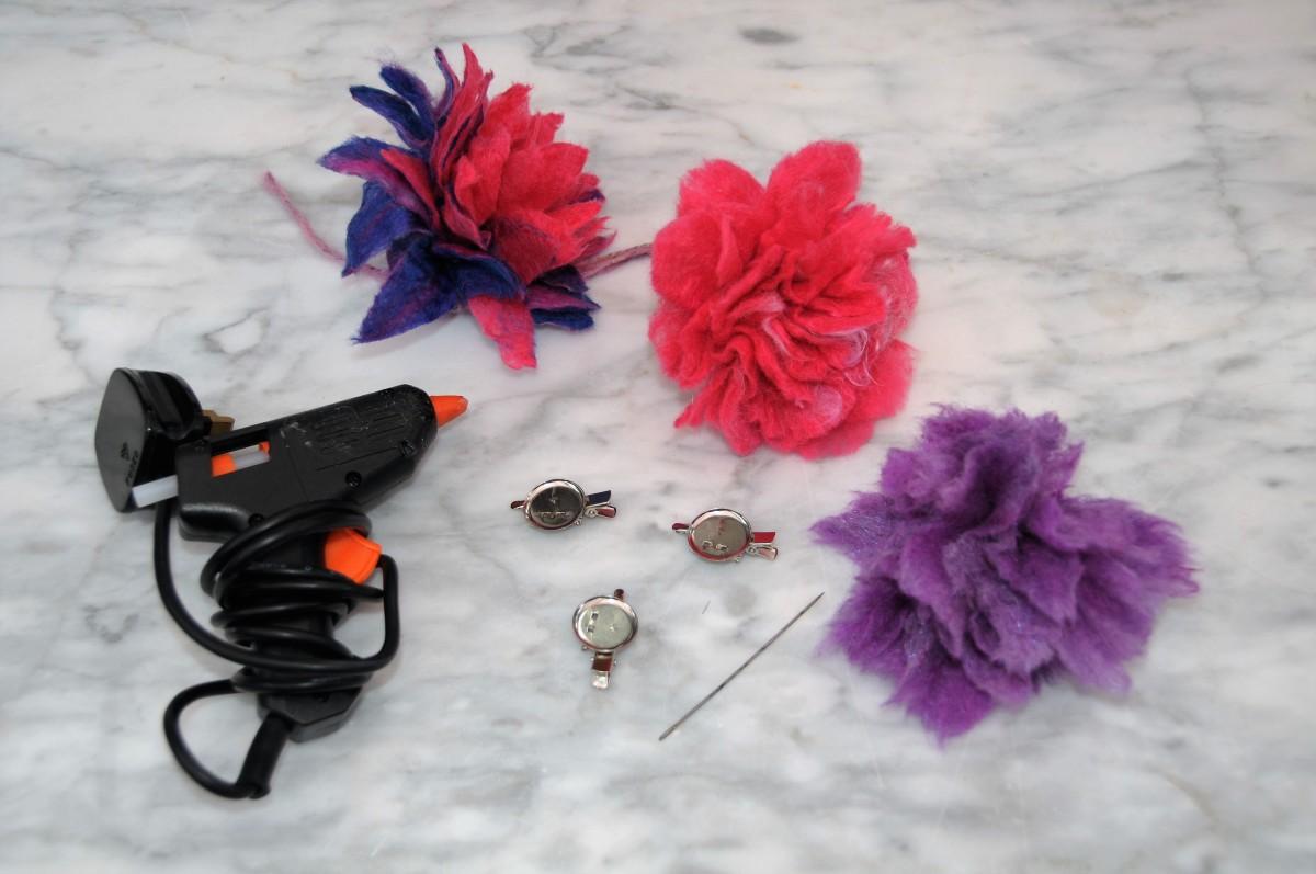 Flowers, hot glue gun and brooch pins