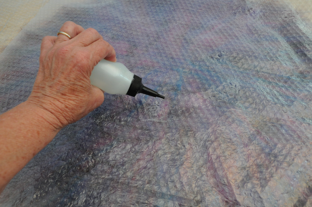 Wet the surface of the bubble wrap with tepid soapy water.