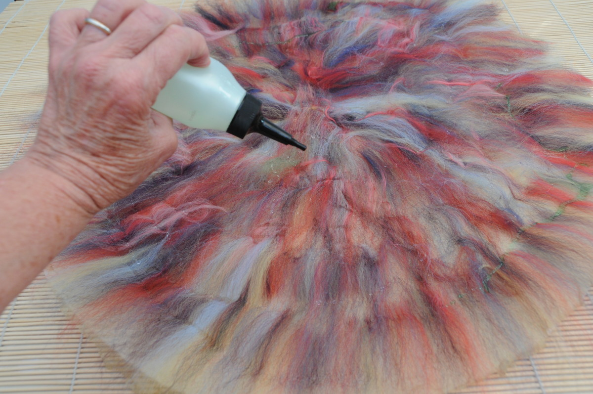 Wetting the fibers with tepid soapy water