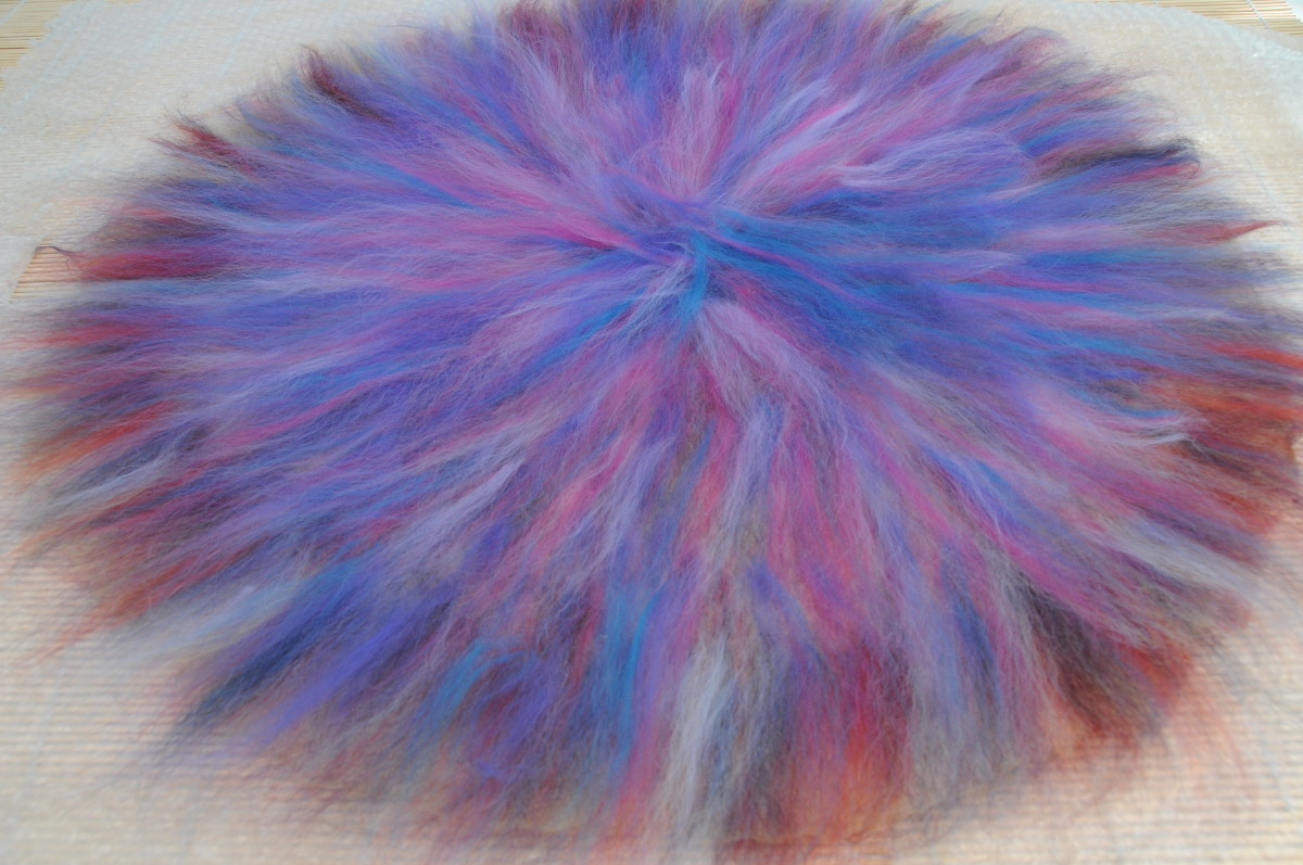 The second side cover in a fine layer of wool roving