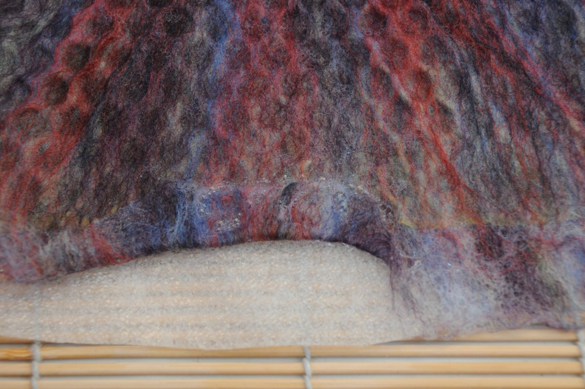 Turn over the fibres to make a neat edge around the whole of the silk layer.