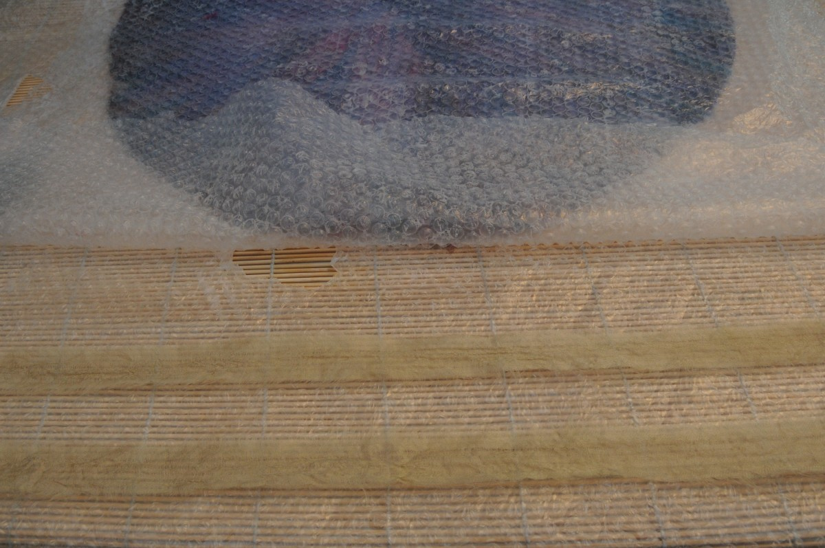 Cut Two Strips of Silk to Create the Two Jacket Ties: Place the 2 strips on a piece of bubble wrap on the blind