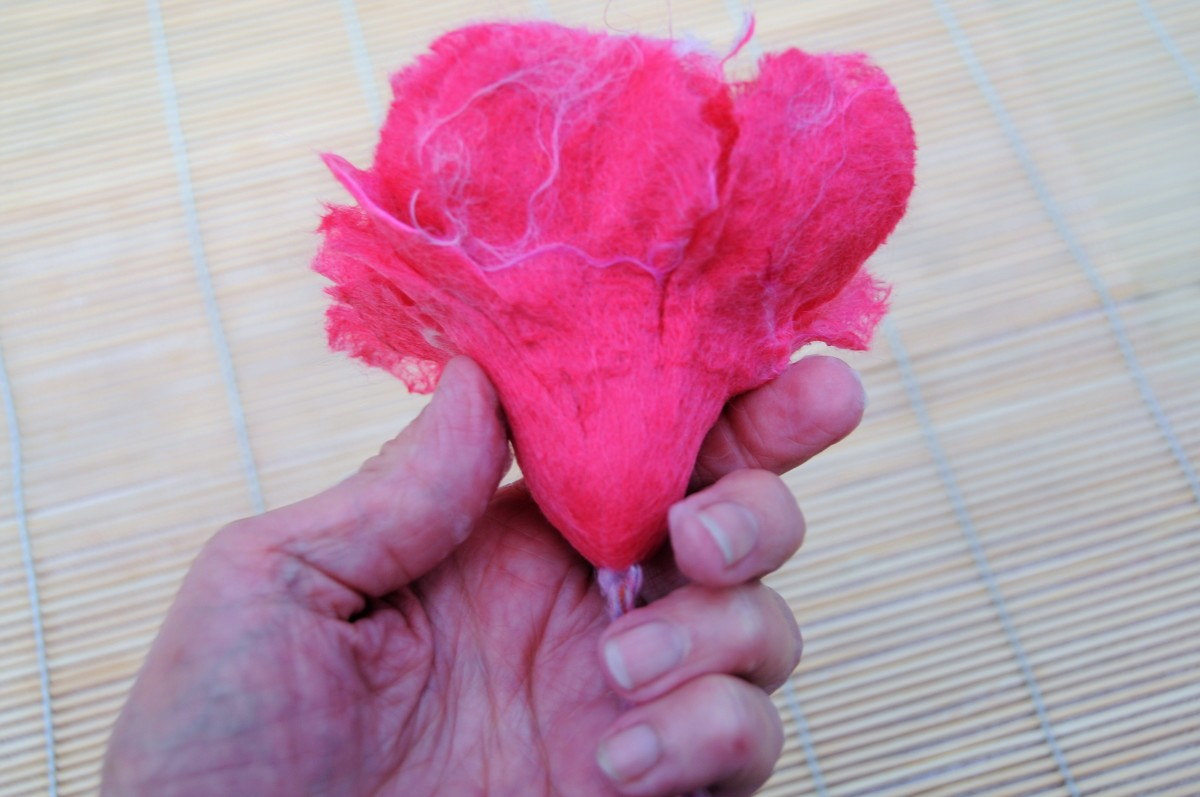 .Rub the Lower Half of the Flower Until It Felts Together