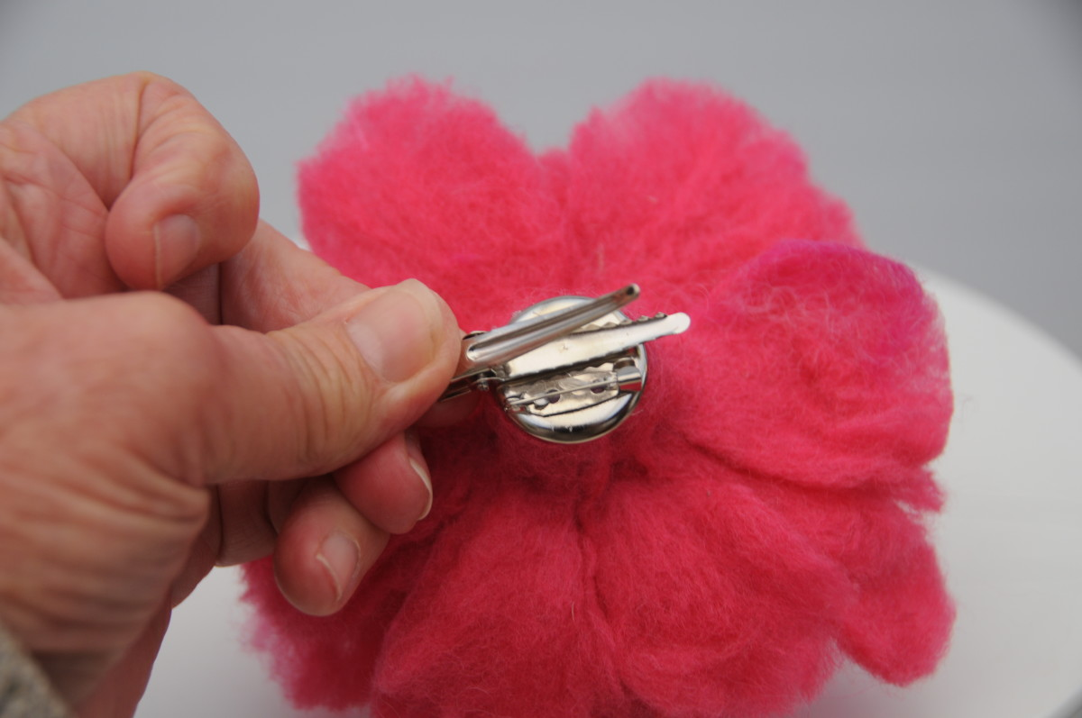 Use a hot glue gun to attach the chrome brooch fixing.