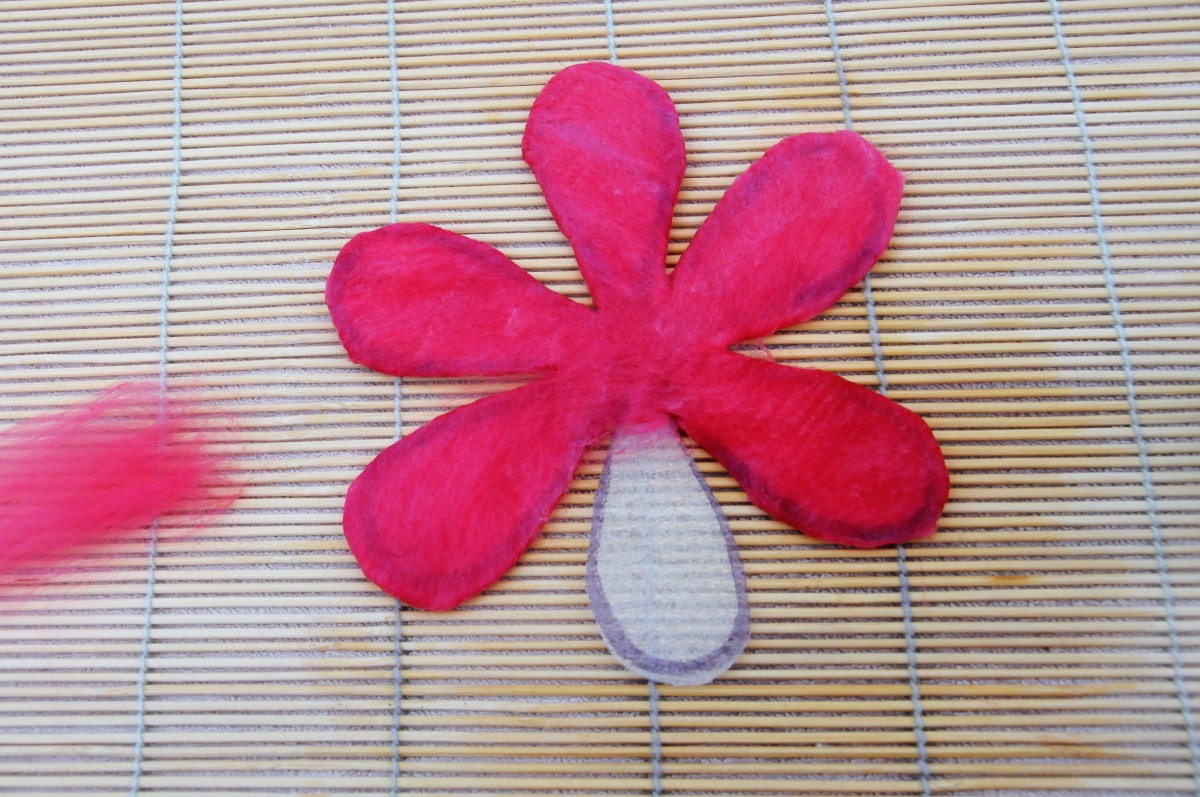 5 of the 6 petals covered in wool roving
