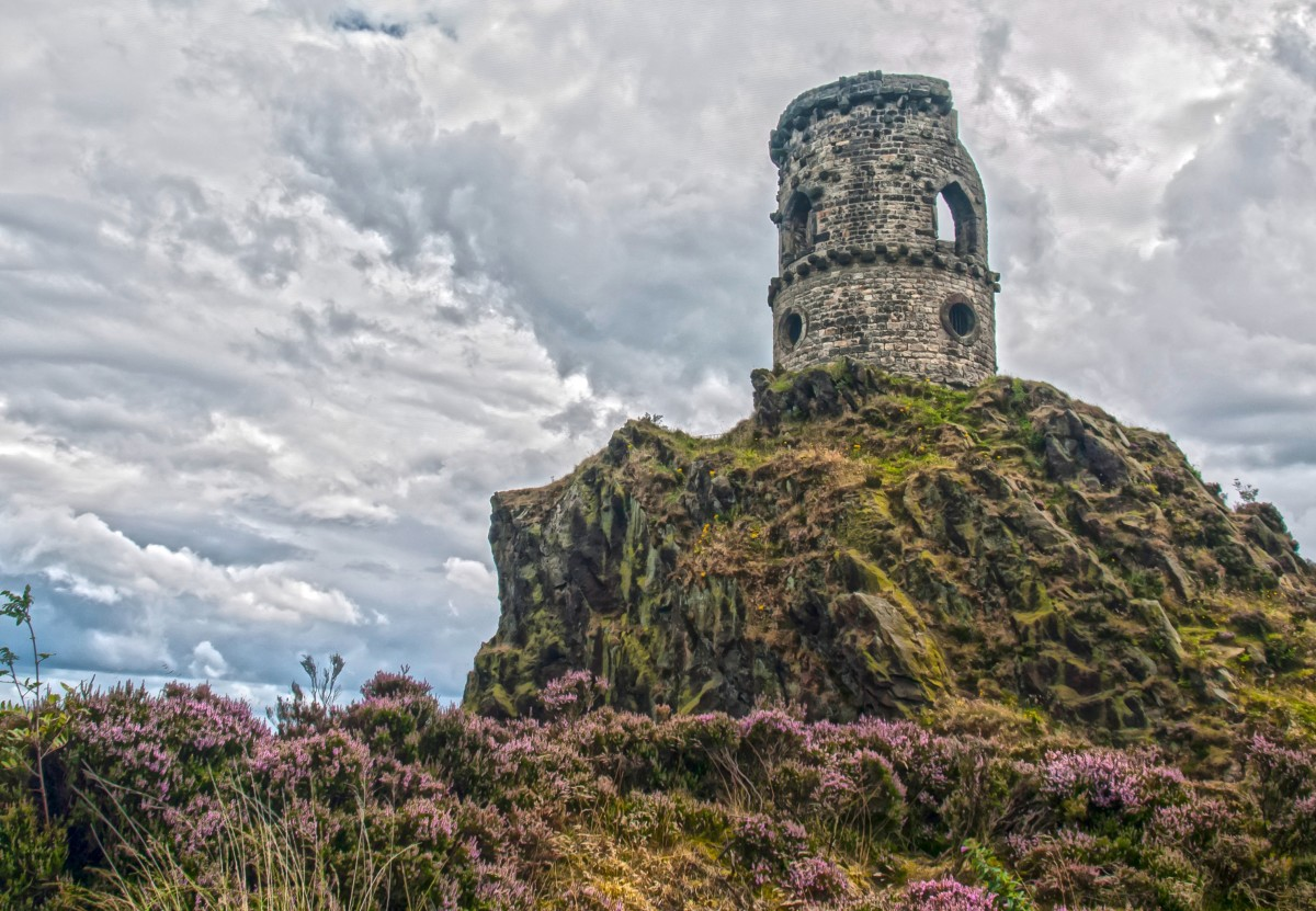 Perched on the summit of a rocky gritstone outcrop The tower or Mow Cop castle is a striking landmark that can be seen from miles around.