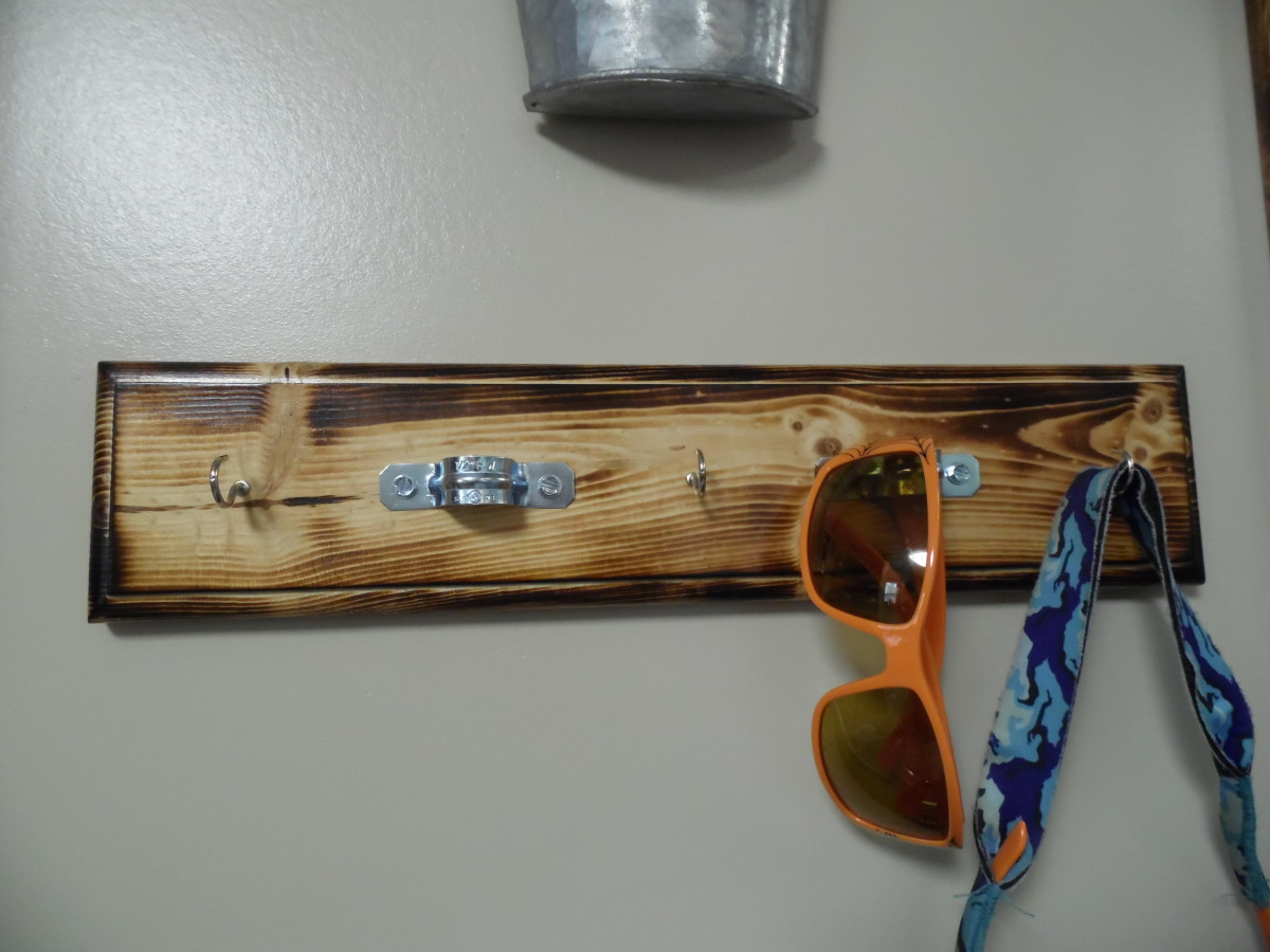 Rustic key holder with burned finish.