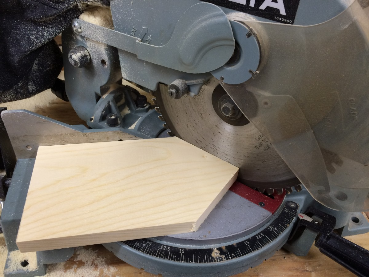 A Miter Box makes quick work of cutting the angled peaks for the roof