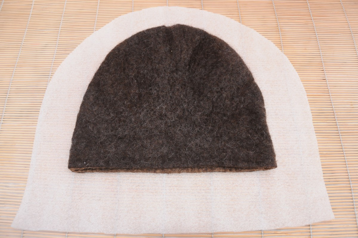 5 cm was cut from the bottom of the hat before inserting the bun into the hat cavity.
