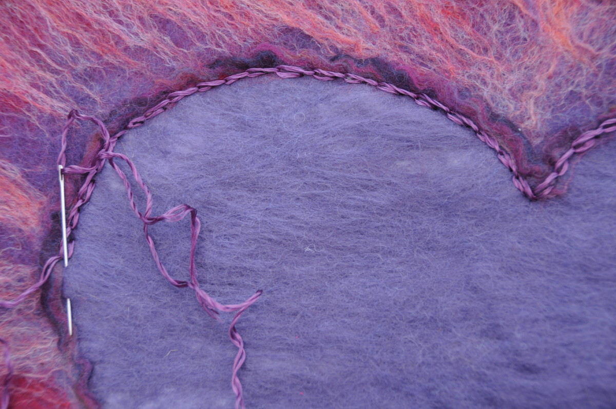 Embroider chain stitches around the inside of the heart with a few strands of embroidery thread.