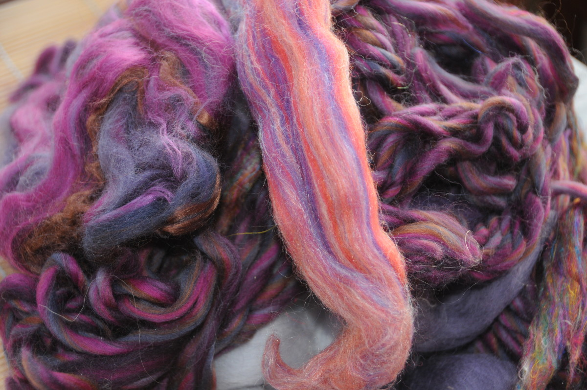 Blended wool roving in complementary colors.