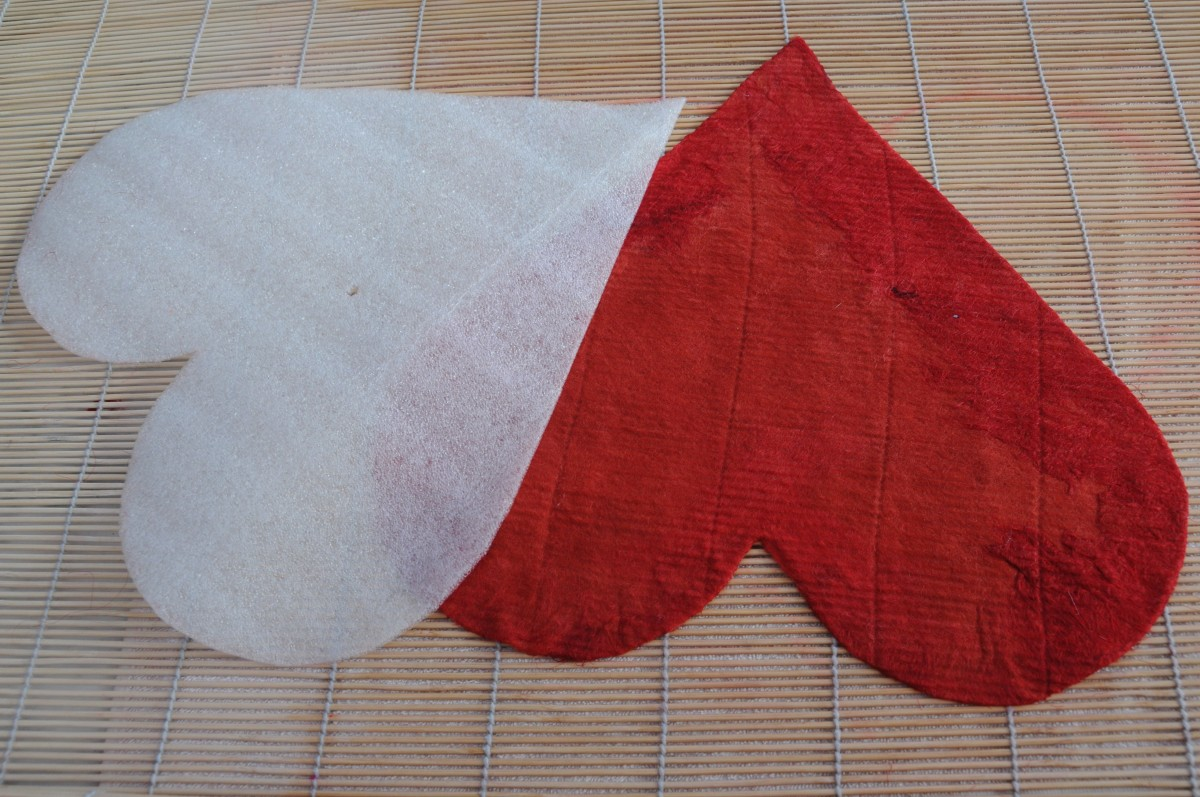 A template covered in red wool.  Be careful not to use red on white if the wool is not color fast.