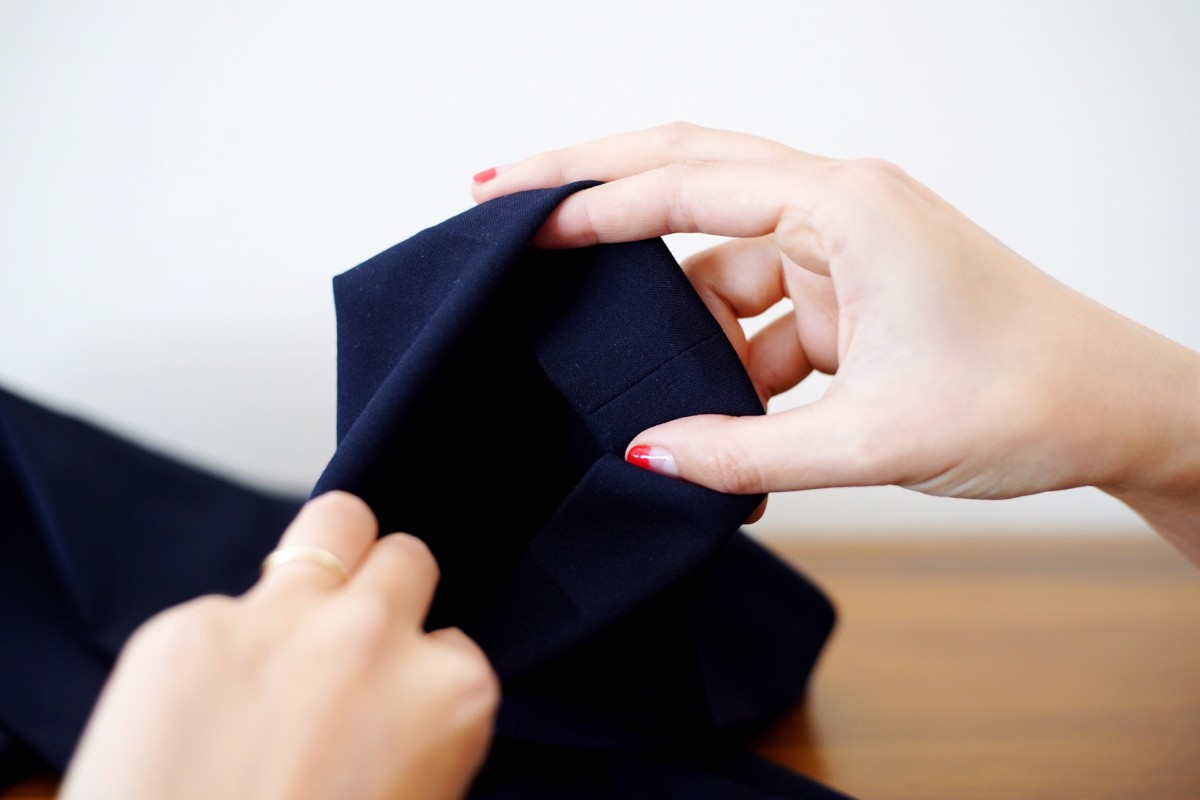 Method 2 (Inside Hem): Fold the hem inwards to the length you want them to hit you. Then, add stitches to keep it in place.