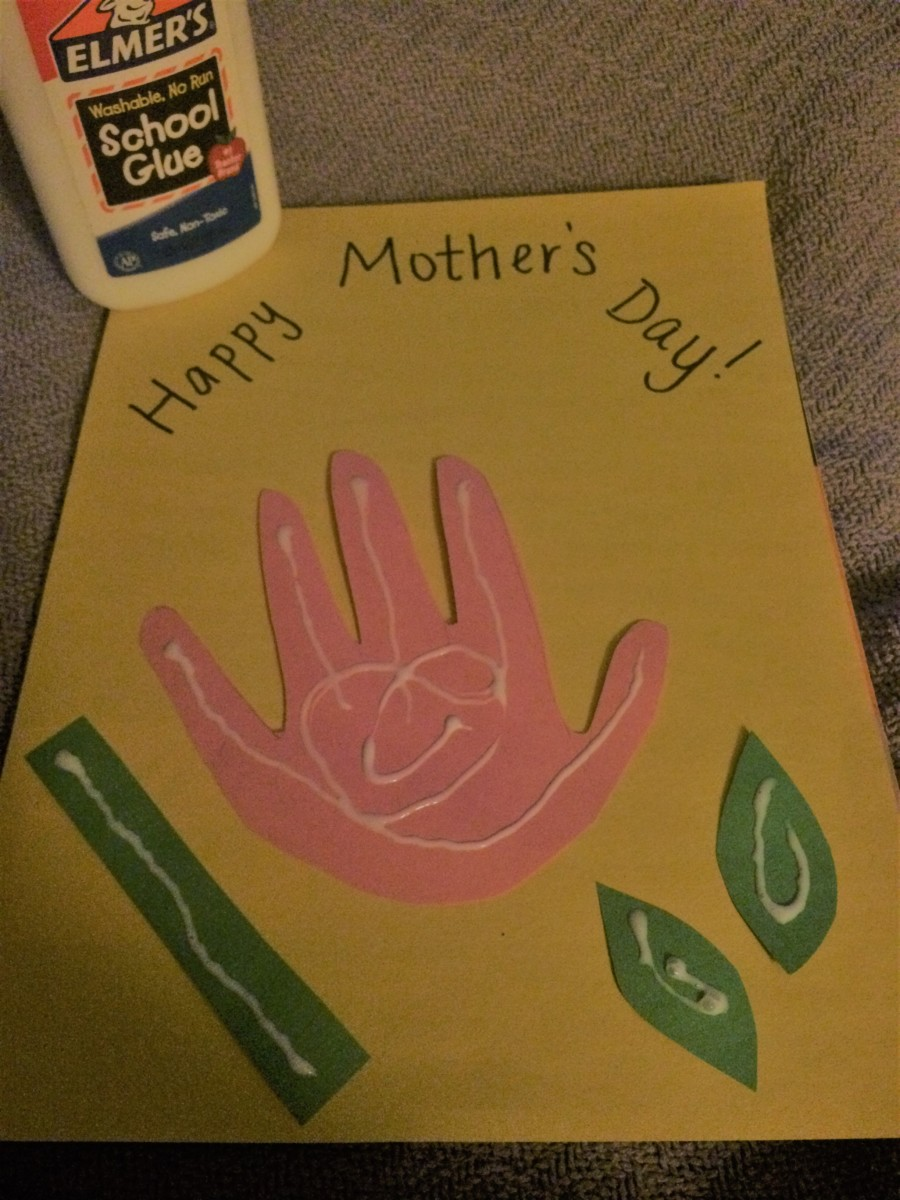 Use glue on the back of the cutouts for the Mother's Day craft.