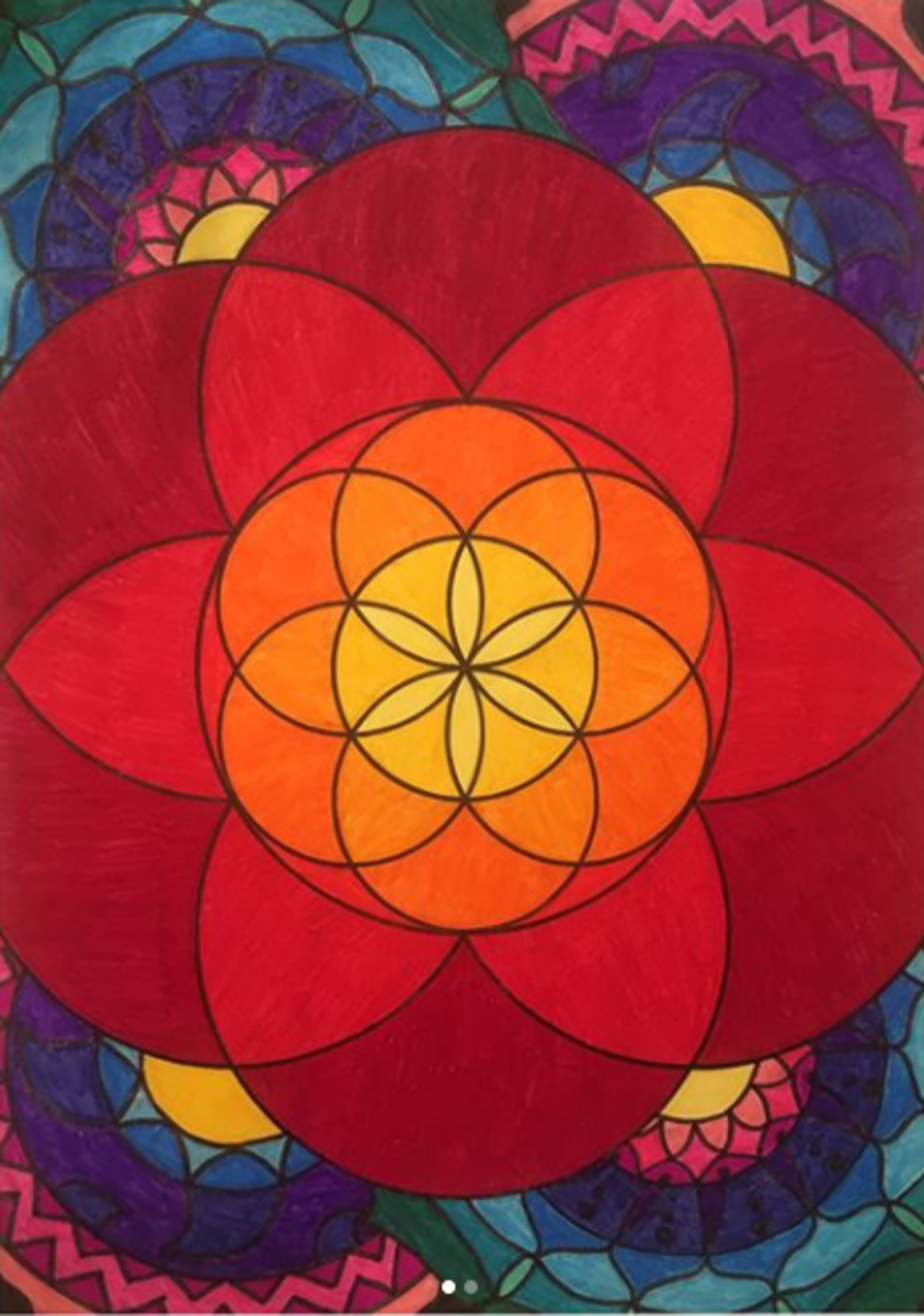 The seed of life in a larger seed of Life, surrounded by mandala designs