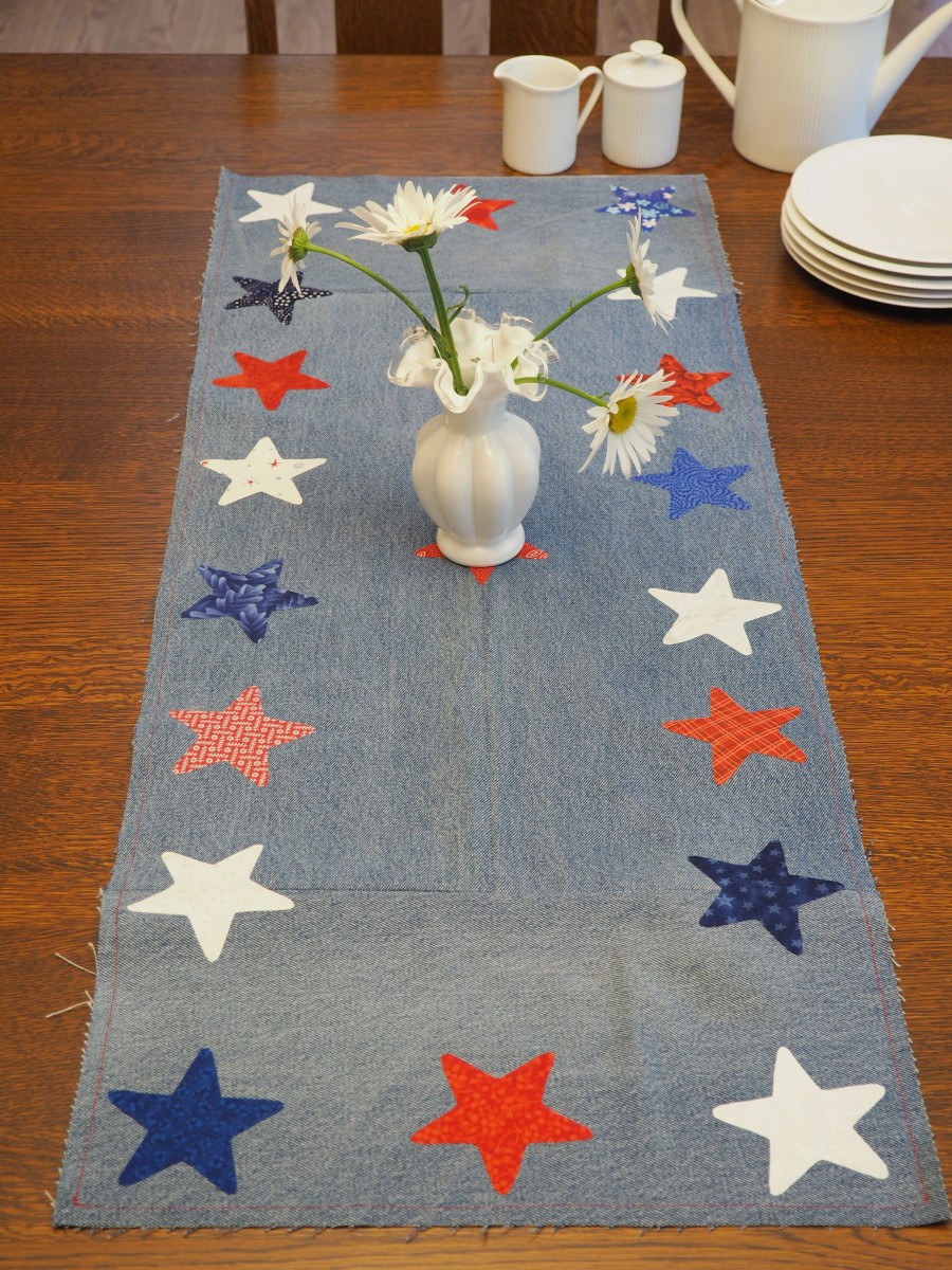 Easy tutorial for a festive DIY table runner made with repurposed blue jeans and fabric scraps.