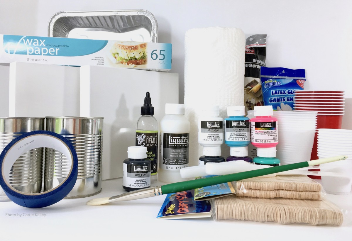 A collection of supplies for pour painting.